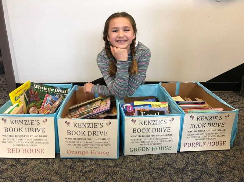 SUBMITTED PHOTO: AMY BIGEJ - MacKenzie Bigej recently held a book drive and collected more than 1,500 books for the Canby Center's Reading Mentors program.