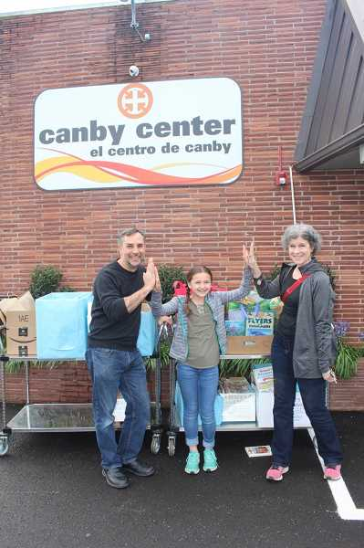 SUBMITTED PHOTO: AMY BIGEJ - MacKenzie Bigej (center) receives congrats from Canby Center Executive Director Ray Keen (left) and Canby Center Reading Mentors Coordinator Kathleen Hanberg.