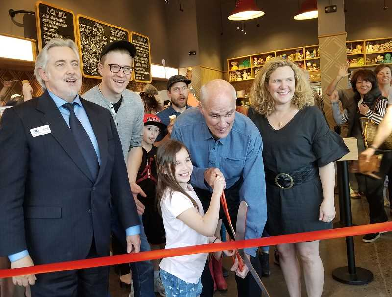 REVIEW PHOTO: GARY M. STEIN - With a little help from Chamber CEO Keith Dickerson (left), Mayor Kent Studebaker and Forest Hills Elementary School fourth-grader Autumn Mahaffey, Tyler and Kim Malek celebrated the opening of their Salt & Straw Ice Cream shop Wednesday evening with a ribbon-cutting ceremony in downtown Lake Oswego. Autumn, who created the flavor 'Sticky Honey Croissant with French Vanilla' as part of Salt & Straw's Student Inventor Series earlier this year, was among the guests of honor at a special preview party inside the scoop shop, which is located in The Windward at the corner of First Street and A Avenue.