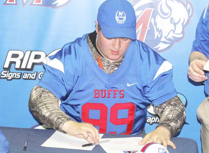 STEELE HAUGEN - Chris Gandy is an eighth-grader who signed a letter of intent to play Madras football.