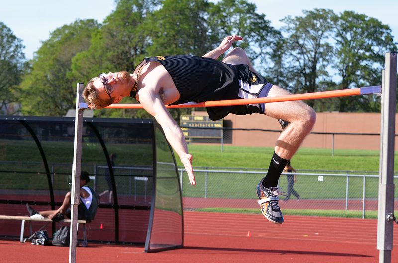 SPOTLIGHT PHOTO: JOHN BREWINGTON - St. Helens senior Dakotah Camberg soared to 6 feet, 6 inches while winning the boys high jump against both Parkrose and The Dalles on Wednesday at St. Helens.