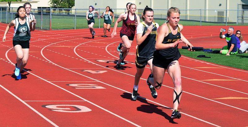 SPOTLIGHT PHOTO: JOHN BREWINGTON - St. Helens' Savannah Moore runs to victory in the 200 meters against both Parkrose and The Dalles on Wednesday at St. Helens.