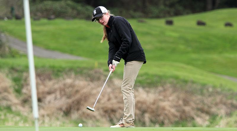 SPOTLIGHT FILE PHOTO - Scappoose senior Kaitlyn Bakkensen (shown here earlier this season) and the Indians stepped up to win the Cowapa League district title at Astoria at Tuesday.