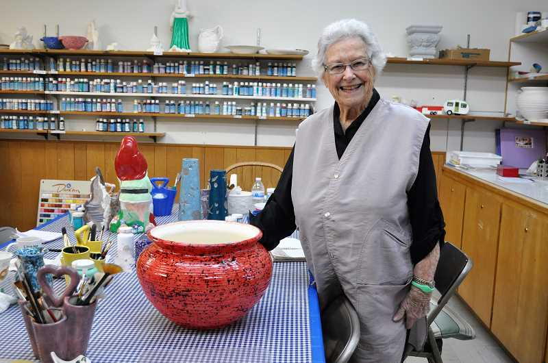 PHOTO: BLAIR STENVICK - Jean Heckler shows off a red ceramic pot she created as part of the King City ceramics club.