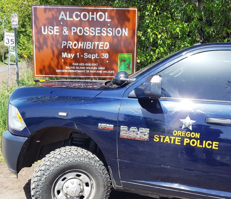 OREGON STATE POLICE - New signage at beach areas on Sauvie Island indicates a seasonal ban on alcoholic beverages from May 1 to Sept. 30.