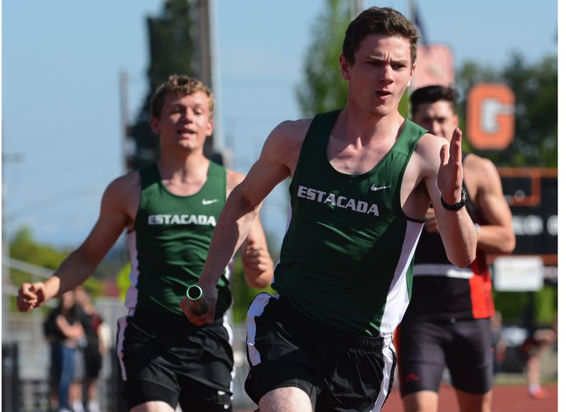 ESTACADA NEWS: DAVID BALL - Estacadas Ben Griffith takes the baton from Logan Stamm during the Rangers trip around the track in the 400-meter relay.