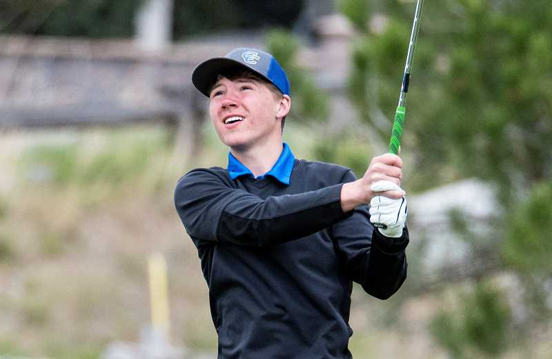 LON AUSTIN/CENTRAL OREGONIAN  - Hogan Smith watches after hitting his tee shot on a par three hole at Meadow Lakes Golf Course on Monday. Smith posted a round of 88 at the tournament, the best of his high school career.