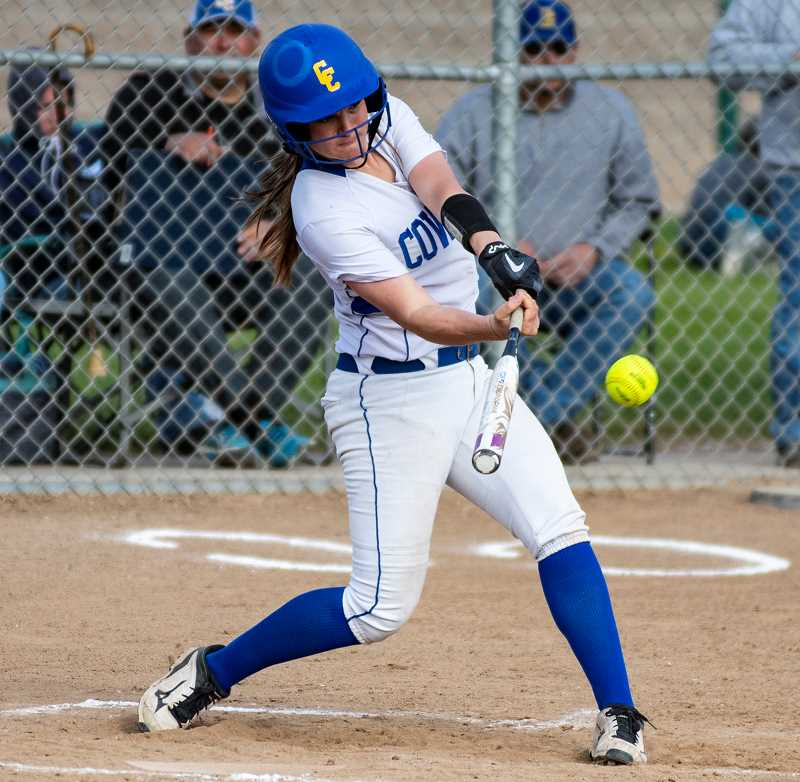 LON AUSTIN/CENTRAL OREGONIAN  - Liz Barker hits a double on Monday against Estacada. The Cowgirls scored five runs in the fifth inning to break open a close game as they won 10-1 against the Rangers.