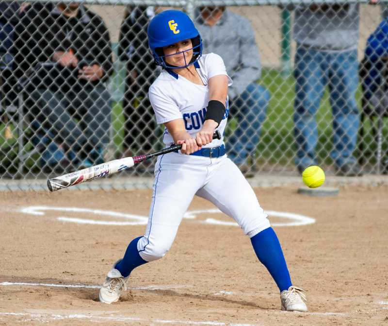 LON AUSTIN/CENTRAL OREGONIAN - Berkley Puckett rips a single during the Cowgirls' victory over the Estacada Rangers on Monday. Crook County won the game 10-1.