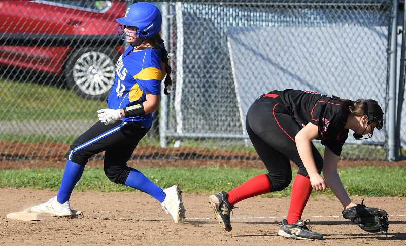 LON AUSTIN/CENTRAL OREGONIAN - Kalyn Martinez hustles into third base ahead of the throw. Martinez was two-for-three at the plate on Wednesday with three RBIs as the Cowgirls defeated the Corbett Cardinals 8-4 in Tri-Valley Conference play.