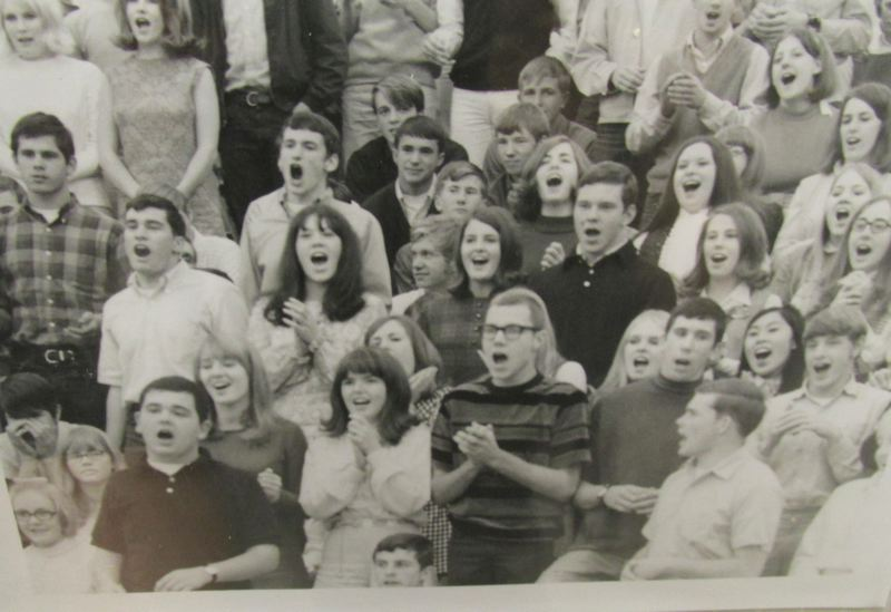 OUTLOOK PHOTO: TERESA CARSON - Diane and her future husband Bob (front and center, wearing striped shirt), cheer the Bruins. Theyre still married.