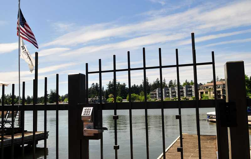REVIEW FILE PHOTO: VERN UYETAKE - Oregon Supreme Court justices heard oral arguments Friday in a case that will decide whether the City of Lake Oswego has the right to bar the public from accessing Oswego Lake.