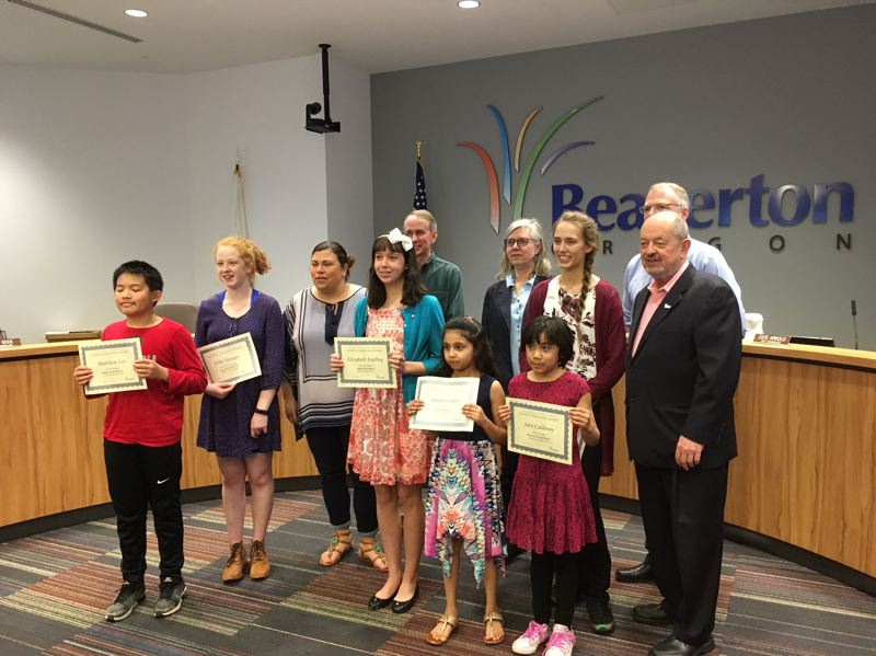 PAMPLIN MEDIA GROUP: PETER WONG - Students were recognized for their expression of human rights during a meeting May 1 of the Beaverton City Council. Students with their certificates are, from left, Matthew Lei, Ellie Younger, Elizabeth Koelling, Smrithi Chary, Sara Calderon, and behind her, Julia Hildebrandt. From left, City Councilors Lacey Beaty, Marc San Soucie, Cate Arnold and Mark Fagin, partly hidden, and Mayor Denny Doyle are to their rear.