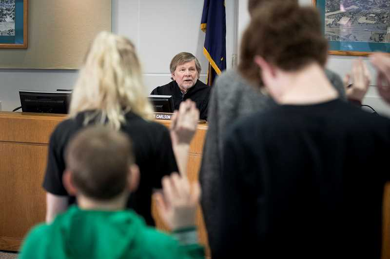 TIMES PHOTO: JAIME VALDEZ - The teen jury takes an oath from Tigard Peer Court Judge Richard Carlson.