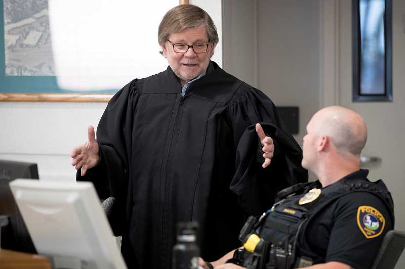 TIMES PHOTO: JAIME VALDEZ - Tigard Peer Court Judge Richard Carlson speaks to the bailiff before Peer Court begins.