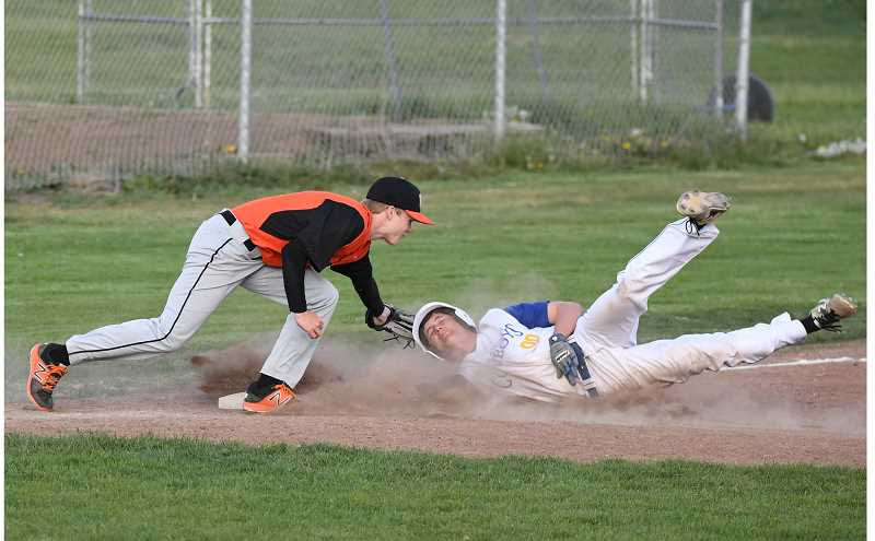 LON AUSTIN/CENTRAL OREGONIAN - Molalla's Linden Mackenzie tags Crook County's Diego Smith out at third base.