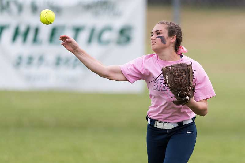STAFF PHOTO: CHRISTOPHER OERTELL - Banks sophomore Halle Vandomelen throws a ball in from right field during the Braves' game against Scappoose May, 4, at Banks High School.