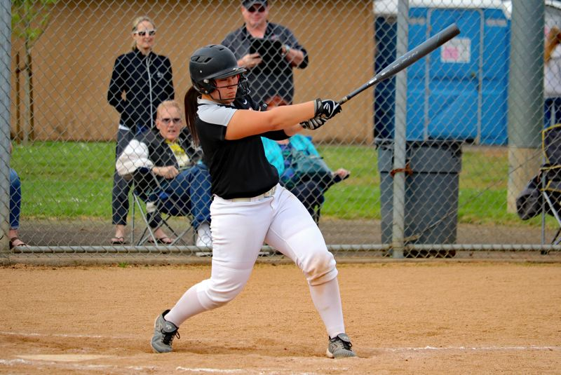 PAMPLIN MEDIA PHOTO: JIM BESEDA - Oregon City's Zoie Iverson watches her two-run homer that keyed a three-run second inning, helping lift the Pioneers to an 11-1 Mt. Hood Conference home win Friday over Clackamas.