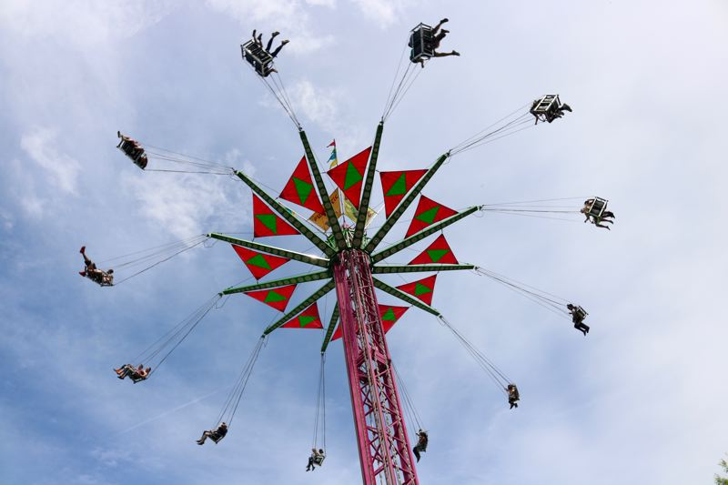 TRIBUNE PHOTO: ZANE SPARLING - Thrill-seekers ride the 'Vertigo' at the carnival section of Cinco de Mayo on Saturday, May 5 in downtown Portland.