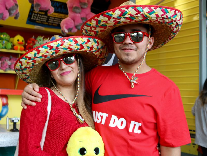 TRIBUNE PHOTO: ZANE SPARLING - Monica Garcia and Angel Manzo pose for a photo during Cinco de Mayo on Saturday, May 5 in downtown Portland.