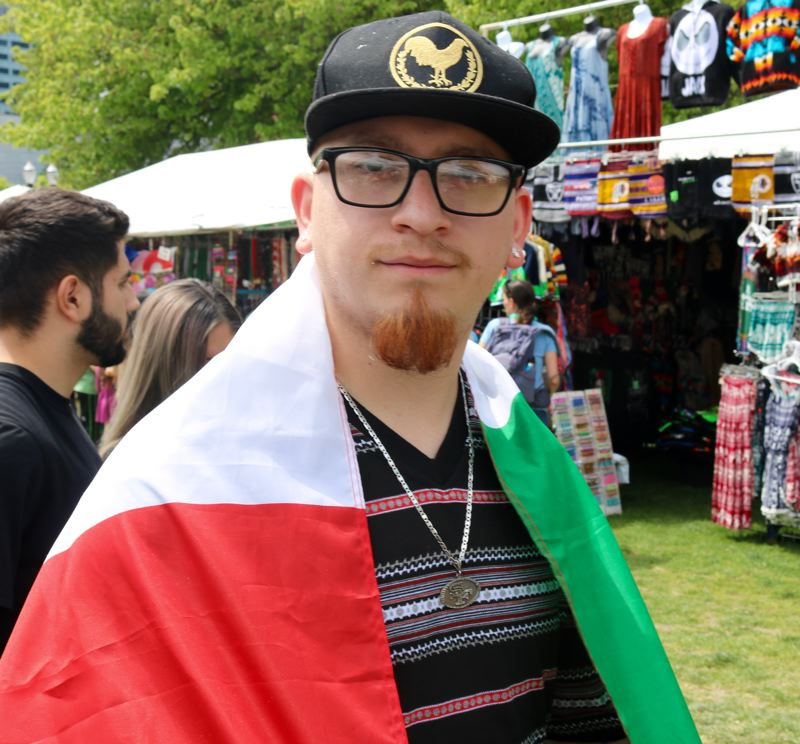 TRIBUNE PHOTO: ZANE SPARLING - Juan Sandoval of Woodburn wore a Mexican flag to Cinco de Mayo on Saturday, May 5 in downtown Portland.