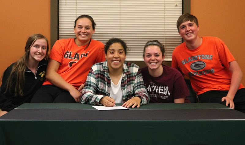 PAMPLIN MEDIA PHOTO: JIM BESEDA - Gladstone's Grace Campbell (center) had classmates (left to right) Morgn Shearer, Shaye Pinner, Zoe Haynes, and Andrew Prom with her Thursday as she signed a letter of intent to play women's basketball at Umpqua Community College in Roseburg.
