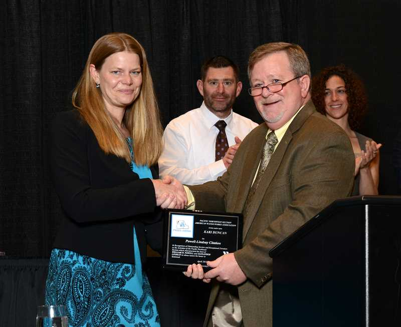 SUBMITTED PHOTO - Kari Duncan (left), manager of the Lake Oswego-Tigard Water Partnership's new water treatment plant in West Linn, accepts the Powell-Lindsay Citation at the American Water Works Associations convention in Tacoma.