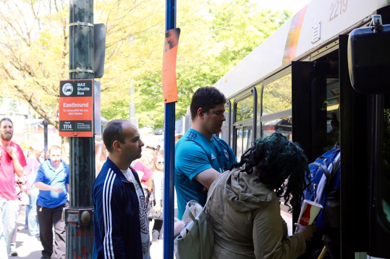 TRIBUNE PHOTO: ZANE SPARLING - Transit riders board a shuttle bus on Southwest Jefferson Street during a six-day disruption of Blue and Red line train service that began on Sunday, May 6.