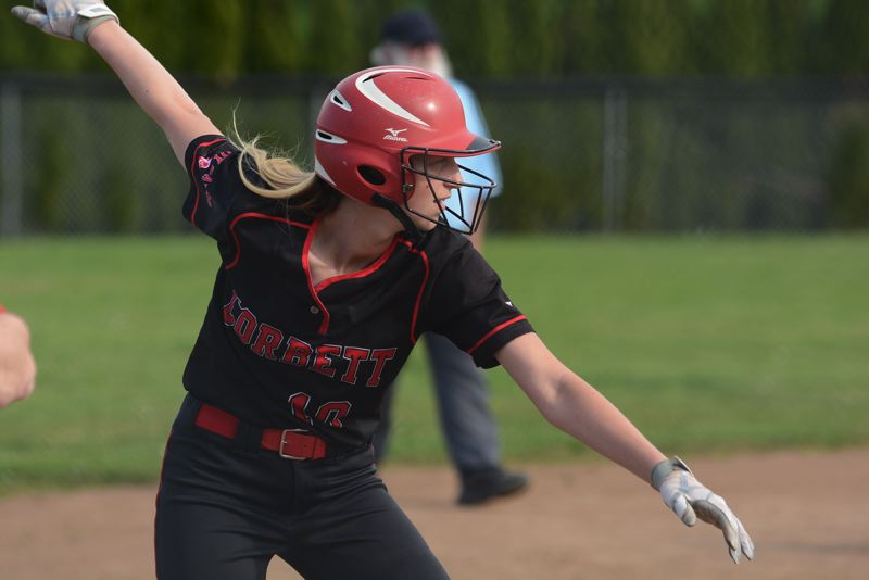 OUTLOOK PHOTO: DAVID BALL - Corbett's Faith McQueen looks to get a jump off third base on her way to scoring a run in the third inning Friday.