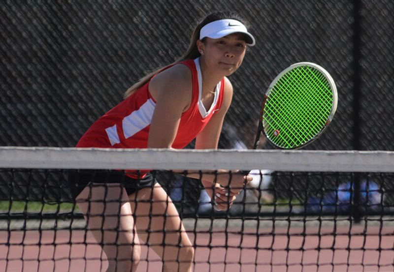 OUTLOOK PHOTO: DAVID BALL - David Douglas senior Jie Tan gets in position at the net. She joins teammate Lillian Troung as the No. 1 seed in the district doubles bracket.