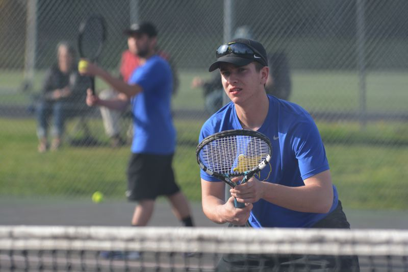 OUTLOOK PHOTO: DAVID BALL - Barlow seniors Gary Curtin (net) and Nick Pritykin enter district as the No. 5 seed, despite having only a handful of matches together.