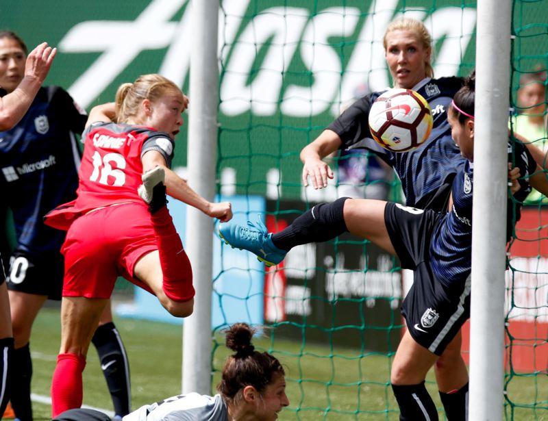 TRIBUNE PHOTO: JONATHAN HOUSE - Emily Sonnett (left) scores from close range for the Portland Thorns in their 3-2 loss Saturday at home to the Seattle Reign.