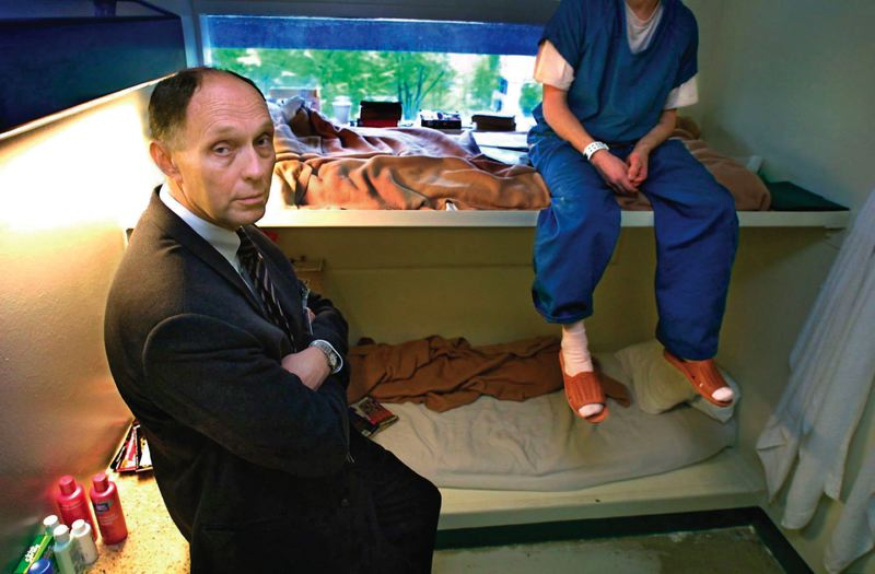 PAMPLIN MEDIA GROUP FILE PHOTO - Multnomah County Sheriff Dan Noelle  visiting a prisoner in a doubled-up cell in 2002. The cells were originally designed for one prisoner but a lack of jail space prompted the county to add extra beds back then.