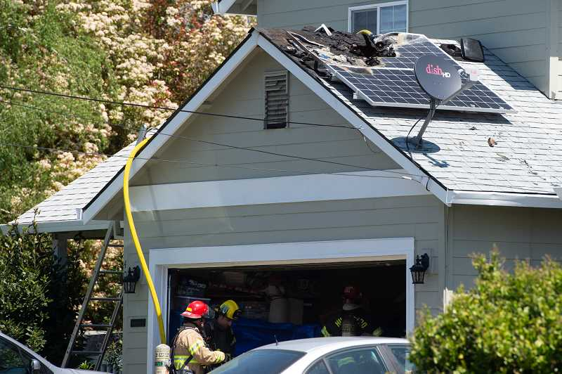 STAFF PHOTO: CHRISTOPHER OERTELL - Damage from the fire was contained to the garage in a fire on S. 26th Ave. in Cornelius, Ore., on Monday, May 7, 2018.