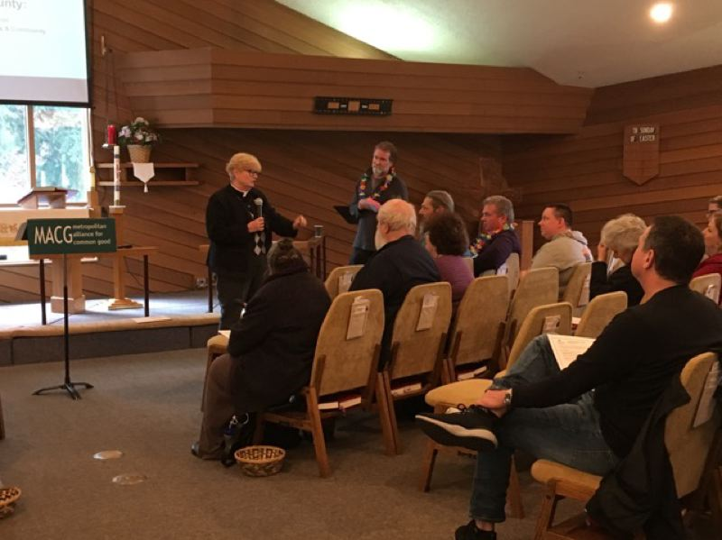 SUBMITTED PHOTO - The Rev. Nancy Gallagher speaks to attendees at the recent Safe Overnight Shelter Open House. To her left is Pastor John Reuter-Harrah, from Oregon City's Prince of Life Lutheran Church.