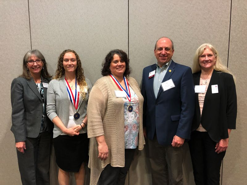 PHOTO COURTESY: CCC - Pictured from left are Clackamas Community College President Joanne Truesdell, Jessica Duran, Kasandra Hartung-Phipps, CCC Board of Education member Dave Hunt and Board of Education Chair Jane Reid.