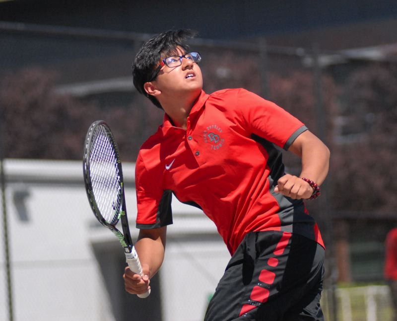 GRESHAM OUTLOOK: MATT RAWLINGS - David Douglas's Steven Van runs back on a ball in his first round singles win on Monday.