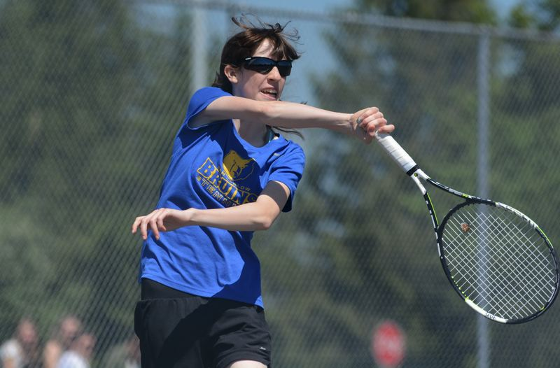 OUTLOOK PHOTO: DAVID BALL - Barlow rookie Olivia O'Halloran hits a forehand return during her three-set win over Oregon City's Scarlet Vance in Monday's opening round of singles play.