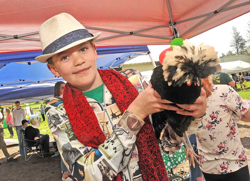 OUTLOOK PHOTO: VERN UYETAKE - Ben White, 12, will be another member of Corbett Critters 4-H at the Multnomah Fair, where he will show Mona Lisa, his chicken.