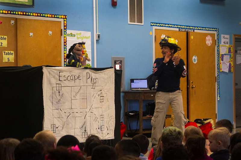 PATRICK EVANS - Fire chief Roberto Martinez teaches fire safety with Azul, a puppet based on a real girl from Nogales who died from smoke inhalation after saving three young boys from a fire.
