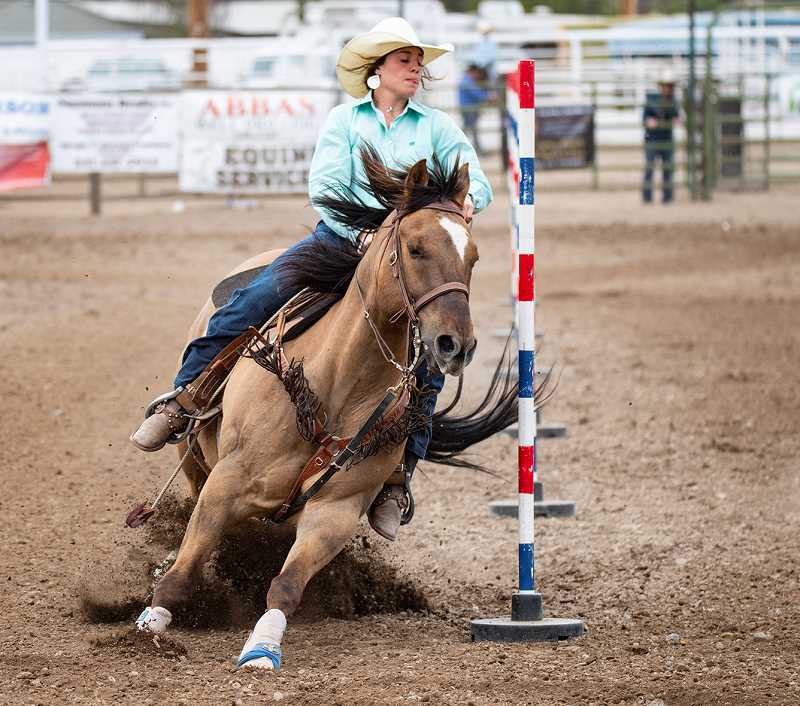 LON AUSTIN/CENTRAL OREGONIAN - Kennedy Buckner wins the pole bending competition on Saturday at the Tri-County Rodeo. Buckner leads both the rookie of the year and the all around standings.