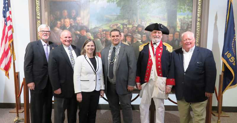 COURTESY PHOTO: JOLENE KELLEY - County Commissioners Kevin Cameron, Sam Brentano and Janet Carlson stand with Historian david Lewis, historical interpreter Michael Tieman, and Greg Leo from the Friends of Historical Butteville in front of a painting depicting Oregon's founding vote.