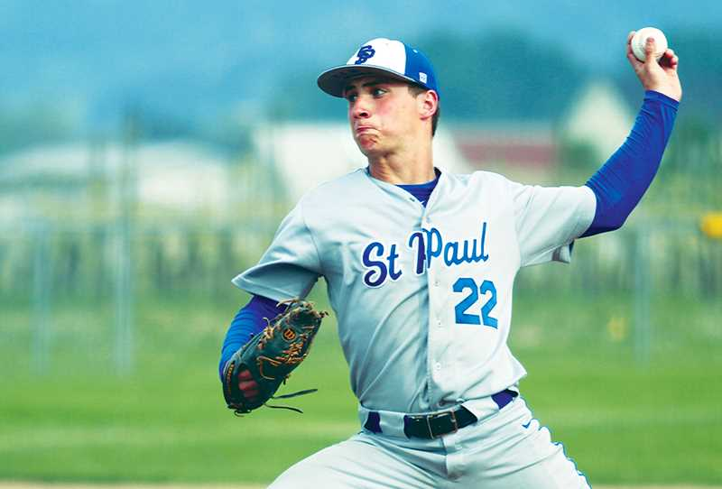 PHIL HAWKINS -- WOODBURN INDEPENDENT - Junior Justin Herberger tosses a complete game for St. Paul Friday as the Bucks upend Tri-River Conference leader Kennedy 9-0.
