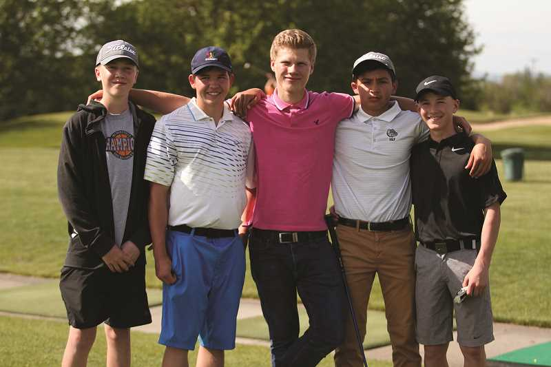 PHIL HAWKINS - The Woodburn boys varsity golf team of (from left) Jordan Blem, Krivoshein, Maverick Cheremnov, Jose Ochoa and Cole Beyer.