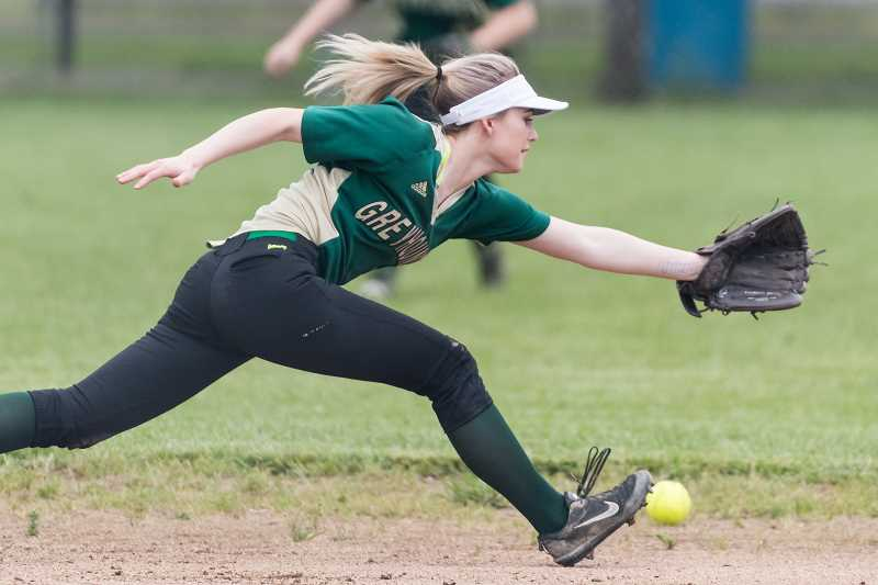 STAFF PHOTO: CHRISTOPHER OERTELL - Gaston's Brooke Jordan stretches for a groundball during the Greyhounds' game against Knappa Tuesday, May 1, at Gaston High School.