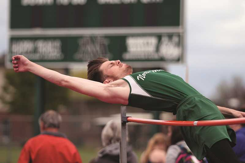PHIL HAWKINS - North Marion junior Jarrett Adair finished runner up in the high jump at the Huskies' home track meet on May 1 and followed with individual wins in the long jump and triple jump.