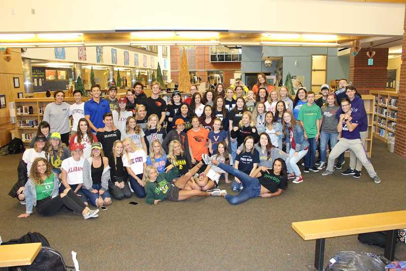 SUBMITTED PHOTO - Wilsonville High School students attending college next year sport their college gear.