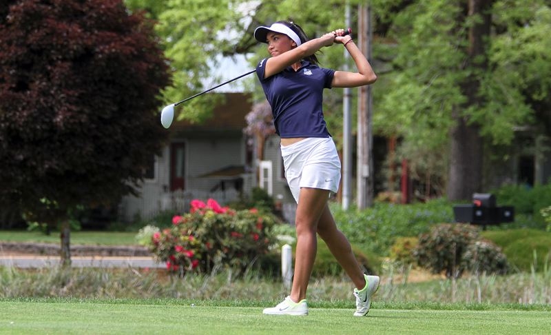 REVIEW PHOTO: MILES VANCE - Lake Oswego's Tya Seth tees off on the 10th hole of the OGA Golf Course in Tukwila during Tuesday's 6A Special District 2 regional tournament.