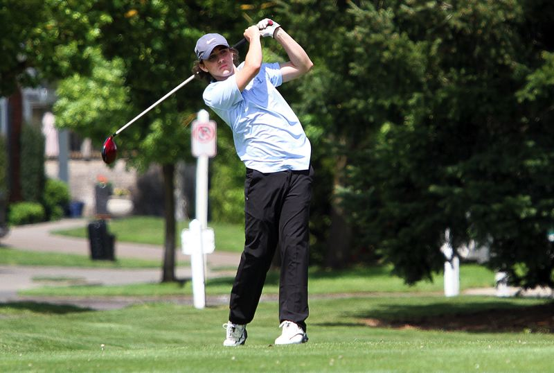 REVIEW PHOTO: MILES VANCE - Lakeridge sophomore Aaron Buck watches his tee shot fly during Tuesday's 6A Special District 2 regional tournament at te OGA Golf Course at Tukwila.