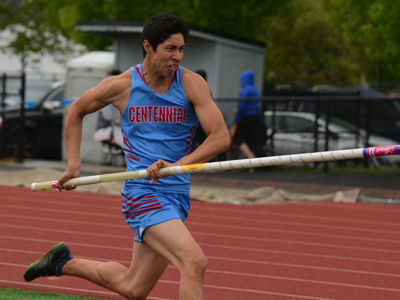 OUTLOOK PHOTO: DAVID BALL - Centennials David Sanchez-Perez makes a trip down the runway on his way to a win in the pole vault Tuesday.
